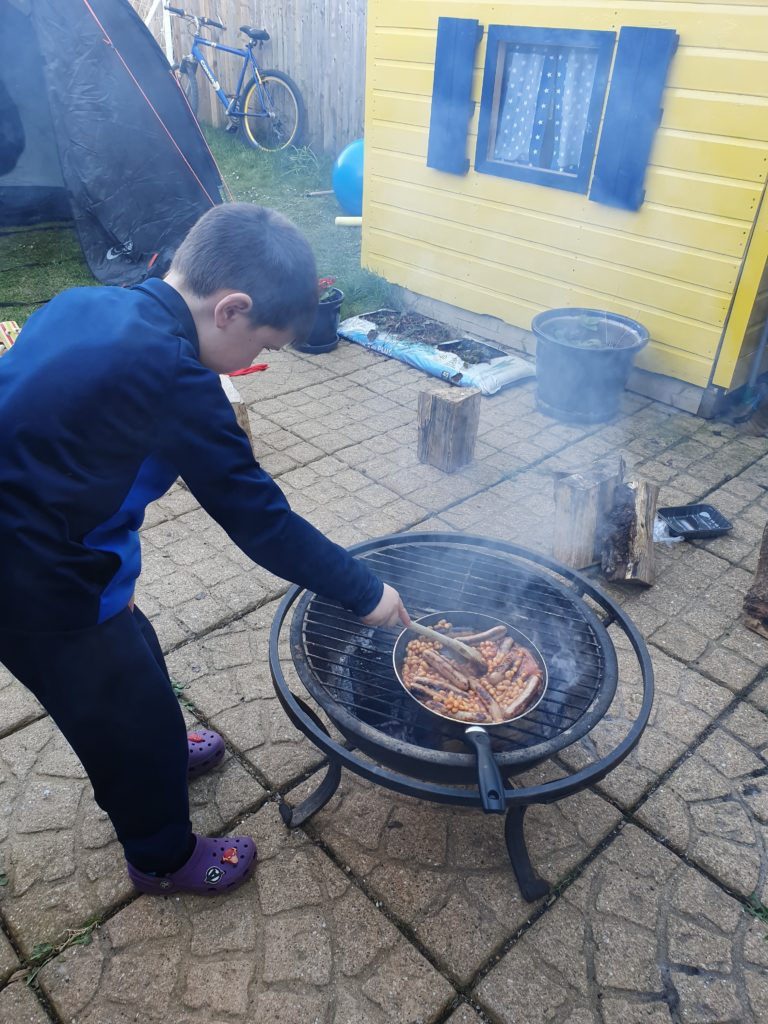 Jacob cooks up sausages and beans