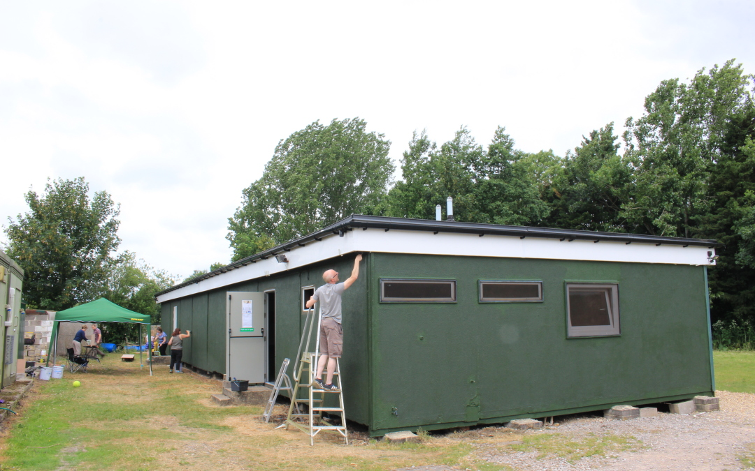 2nd coat of paint goes on the hut